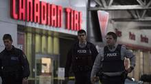 Police are seen outside a Canadian Tire store in Vancouver, B.C. Thursday, Nov. 10, 2016. (JONATHAN HAYWARD/THE CANADIAN PRESS)