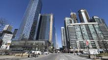 The Southcore Financial Centre, including the Delta Hotel, left, slated to open later in 2014. (Fred Lum/The Globe and Mail)