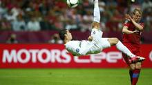 Portugal's Cristiano Ronaldo kicks the ball in front of Czech Republic's Michal Kadlec (R) during their Euro 2012 quarter-final soccer match at the National stadium in Warsaw, June 21, 2012. (KAI PFAFFENBACH/REUTERS)