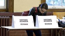 A woman casts her ballot in the Ontario election at a Toronto poling station on Oct. 6, 2011. (Chris Young/THE CANADIAN PRESS)