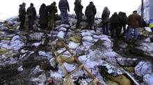 People stand on the barricades in Kiev on Feb. 4, 2014.