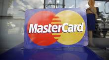 On April 3, most members' interchange fees for regular credit cards will drop by 12.5 per cent to 1.26 per cent of the value of a customer's purchase from 1.44 per cent currently. (Soe Zeya Tun/Reuters)