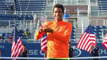Félix Auger-Aliassime celebrates with the trophy after defeating Miomir Kecmanovic for the U.S. Open boys' title on Sept. 11, 2016. (Mike Stobe/Getty Images for USTA)