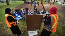 Students pulled from schools in the Thorncliffe Park area take part in class in a park beside Thornclife Park Public School on Sept 9 2015. Parents pulled their children to protest the current provincial sex ed curriculum. (Fred Lum/The Globe and Mail)