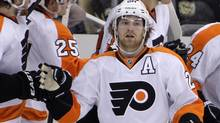 Philadelphia Flyers' Claude Giroux (28) returns to the bench after scoring in the second period of an opening-round NHL hockey playoff series against the Pittsburgh Penguins in Pittsburgh, Friday, April 13, 2012. (Associated Press)