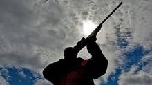 A rifle owner takes aim at a hunting camp near Ottawa on Sept. 15, 2010. (Sean Kilpatrick/THE CANADIAN PRESS)