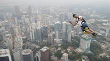 Base jumper Kristian Moxnes of Norway leaps from the 300-metre Open Deck of Malaysia's landmark Kuala Lumpur Tower. (Vincent Thian/AP)