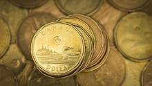 The emergence of the Canadian dollar as a commodity currency was not one of the objectives of the inflation-targeting regime, but it has become one of its unintended consequences. (MARK BLINCH/REUTERS)