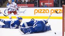 New York Rangers centre Derek Stepan (21) scores past Toronto Maple Leafs goalie Jonathan Bernier (45) as Toronto Maple Leafs defenceman Frank Corrado (20) looks on during third period NHL hockey action in Toronto on Thursday, February 18, 2016. (Nathan Denette/THE CANADIAN PRESS)