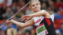Brianne Theisen-Eaton of Canada competes in the women's heptathlon javelin throw at Commonwealth Games in Glasgow on Wednesday. (SUZANNE PLUNKETT/REUTERS)
