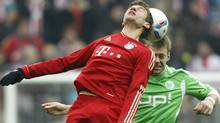 Bayern's Thomas Mueller, foreground, and Wolfsburg's Marco Russ challenge for the ball during the German first division Bundesliga soccer match between FC Bayern Munich and VfL Wolfsburg in Munich, southern Germany, on Saturday, Jan. 28, 2012. (AP Photo/Matthias Schrader) (Matthias Schrader/AP)