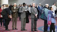 In this March 7, 2012, file photo shows job seekers standing line during the Career Expo job fair, in Portland, Ore. Employers pulled back sharply on hiring last month, a reminder that the U.S. economy may not be growing fast enough to sustain robust job growth. The unemployment rate dipped, but mostly because more Americans stopped looking for work. The Labor Department says the economy added 120,000 jobs in March, down from more than 200,000 in each of the previous three months. (Rick Bowmer/Rick Bowmer for The Associated Press)