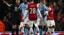 Referee Mike Dean asks Manchester City's Vincent Kompany to leave the pitch after showing him the red card during their English Premier League soccer match against Arsenal at the Emirates Stadium in London January 13, 2013. (EDDIE KEOGH/REUTERS)