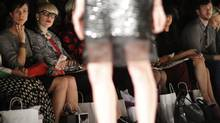 Spectators look at the models wearing the creations of fashion designer David Dixon during his show, part of Toronto Fashion Week October 21, 2013 2013. (Fernando Morales/The Globe and Mail)