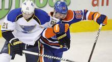 St. Louis Blues' Patrik Berglund, left, battles Edmonton Oilers' Sam Gagner during first period NHL hockey game action in Edmonton on Wednesday, February 29, 2012. (John Ulan/THE CANADIAN PRESS)