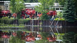Workers remove oil from the Ceresco dam on the Kalamazoo River Marshall, Mi. after Enbridge's oil pipeline ruptured spewing more than 3 million liters of crude into the waterway.
