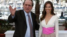 "Director and actor Tommy Lee Jones (L) and cast member Hilary Swank pose during a photocall for the film ""The Homesman"" in competition at the 67th Cannes Film Festival in Cannes May 18. (BENOIT TESSIER/REUTERS)"