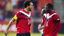 Canada's Dwayne De Rosario (L) celebrates his goal against St. Kitts and Nevis with teammate Olivier Occean during their 2014 World Cup qualifying soccer match in Toronto November 15, 2011. (MARK BLINCH/REUTERS)