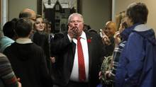 """Toronto Mayor Rob Ford blows a kiss to the media while touring City Hall during the annual Take Your Kid to Work Day on Nov. 6, 2013. (FERNANDO MORALES/THE GLOBE AND MAIL)"