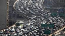 The morning rush hour clogs a highway in Shanghai in this file photo. China is poised to overtake the United States as the world's leading oil importer this year. (CARLOS BARRIA/REUTERS)
