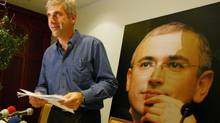 Leonid Nevzlin, the exiled partner of Russian oil tycoon Mikhail Khodorkovsky, pictured in background, speaks after a news conference in this photo taken in Tel Aviv, Israel, Tuesday, May 31, 2005. (BRENNAN LINSLEY/AP)