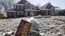 In this Wednesday, May 18, 2016, file photo, a 'Sold' sign rests in front of a house under construction, in Walpole, Mass. (Steven Senne/AP)
