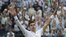 Milos Raonic of Canada reacts after defeating Nick Kyrgios of Australia in their men's singles quarter-final tennis match against at the Wimbledon Tennis Championships, in London July 2, 2014. (MAX ROSSI/REUTERS)
