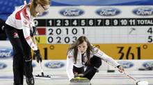 Canada's skip Rachel Homan delivers a stone during their World Women's Curling Championship qualification round match against Italy in Riga March 19, 2013. (INTS KALNINS/REUTERS)