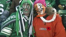 Fans brave the cold during the CFL Western Semi-Final in Regina, Sask., Sunday, November 10, 2013. (Liam Richards/THE CANADIAN PRESS)