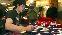 Montreal Canadiens goaltender Carey Price autographs souveniers at the end of season media availability  Thursday, April 28, 2011  in Brossard, Que. (The Canadian Press)