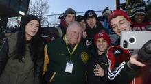 Toronto Mayor Rob Ford poses for a photo with spectators at Centennial Park in Etobicoke on Nov. 29, 2013. (Fred Lum/The Globe and Mail)