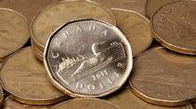 Hedging some of your holdings now protects you in case of a near-term rebound in the dollar. (JONATHAN HAYWARD/THE CANADIAN PRESS)