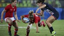 Ashley Steacy of Canada is tackled by Alice Richardson of the U.K. during women's bronze medal rugby action at the Rio Olympics on August 8, 2016. (Alessandro Bianchi/Reuters)