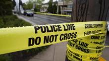 Police arrested seven people after receiving a gun call from St. Joseph's Catholic Elementary School in Hamilton on June 19, 2013. (Rafal Gerszak For The Globe and Mail)