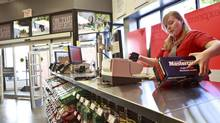 Checking out at Canadian stores now, instead of fake money, you might see a customer whip out a cellphone and check their Canadian Tire Money total. (Gloria Nieto/The Globe and Mail)