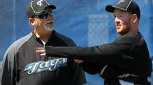 Toronto Blue Jays pitching coach Bruce Walton, left, speaks with an injured Jesse Litsch at the Blue Jays' spring training baseball facility in Dunedin, Fla. Monday, March 1, 2010. THE CANADIAN PRESS/Darren Calabrese (Darren Calabrese)