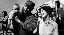 Margaret Trudeau smiles as Castro holds her youngest son Michel after the Trudeaus arrived in Havana, Cuba, Jan. 26, 1976. (Fred Chartrand/Fred Chartrand/The Canadian Press)