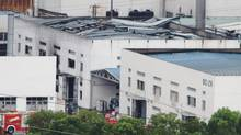 This photo released by China's Xinhua News Agency shows the damaged workshop following an explosion at an eastern Chinese automotive parts factory in Kunshan, Jiangsu Province Saturday, Aug. 2. (Zhu Guigen/AP)