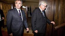Premier-designate Jim Prentice and Alberta interim Premier Dave Hancock meet in Edmonton on Monday. (JASON FRANSON/THE CANADIAN PRESS)