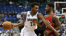 Minnesota Timberwolves standout Andrew Wiggins, left, has been called everything from Maple Jordan to the face of Canadian basketball. (Stacy Bengs/AP)