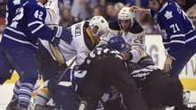 Buffalo Sabres and Toronto Maple Leafs pile-up during third period NHL action in Toronto, Sunday Sept. 22, 2013. David Clarkson (71) is at right. (Frank Gunn/THE CANADIAN PRESS)