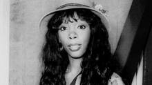 Donna Summer arrives at London's Heathrow Airport from Paris in 1977, back when she ruled the dance floors of the world. (AP)