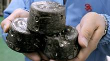 Chunks of chemically processed rare earths are shown in Beijing.