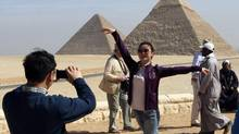 Foreign tourists photograph each other at the Pyramids in Cairo February 12, 2009. (Tarek Mostafa/Reuters)