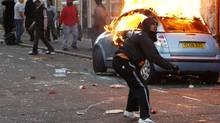 A rioter throws a rock at riot police in Clarence Road in Hackney on August 8, 2011 in London, England. (Dan Istitene/Getty Images)