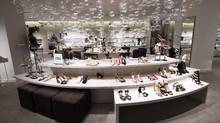 The new Saks Fifth Avenue in Toronto boasts about 1,000 pairs of shoes. The growth of the luxury trade is one of the factors that has made Toronto's downtown among the most vibrant in North America. (NATHAN DENETTE/THE CANADIAN PRESS)