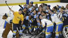 """In this Sunday, Jan. 24, 2016, photo, National Women's Hockey League All-Star players take time for a """"selfie"""" before the start of an all-star game at Harborcenter in Buffalo, N.Y. (Gary Wiepert/AP)"""