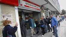 People stand in line to enter a government-run employment office in Madrid April 27, 2012. (ANDREA COMAS/ANDREA COMAS/REUTERS)