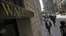 Morning commuters walk on Wall Street in New York's financial district September 5, 2013. (BRENDAN MCDERMID/REUTERS)