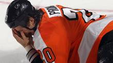 Chris Pronger #20 of the Philadelphia Flyers falls to the ice after being hit in the face by a stick during the game against the Toronto Maple Leafs at Wells Fargo Center on October 24, 2011 in Philadelphia, Pennsylvania. Pronger has since announced he has blurred vision due to the injury. (Photo by Bruce Bennett/Getty Images) (Bruce Bennett/Getty Images)